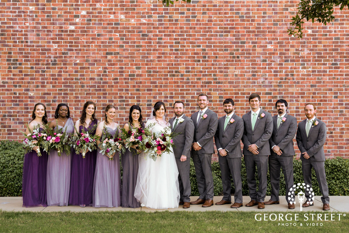 lovable couple with bridesmaids and groomsmen