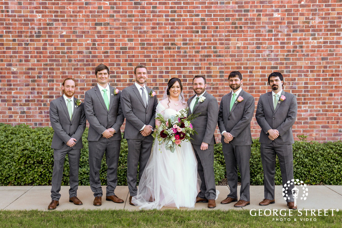 lovely couple with bridemaids and groomsmen at the nylo hotel in dallas