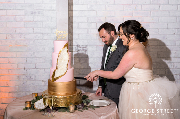 loving bride and groom cake cutting ceremony in reception wedding photos