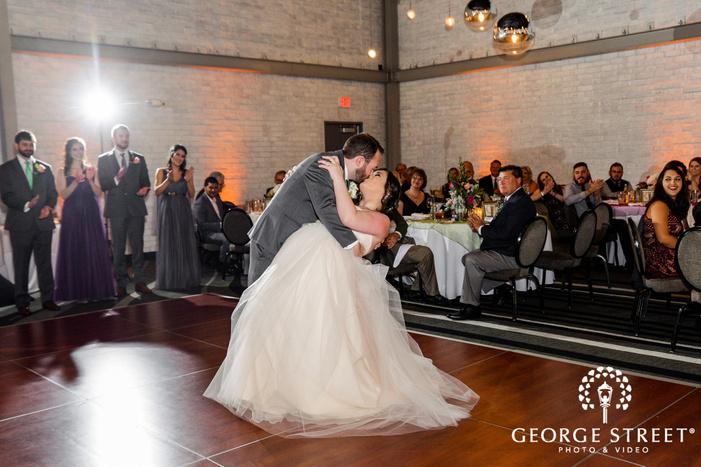 romantic bride and groom dance on reception