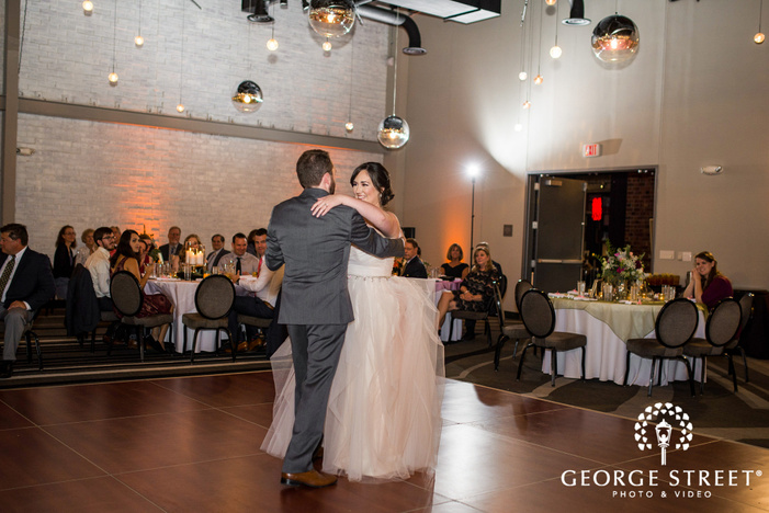 sweet bride and groom dance on reception