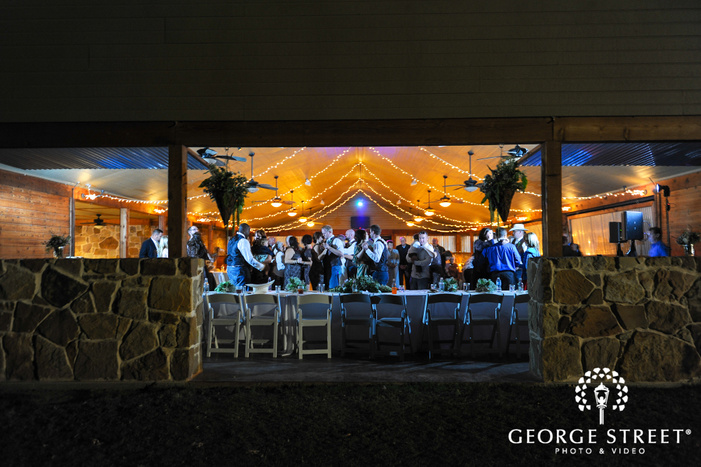 Farmhouse reception guests dancing