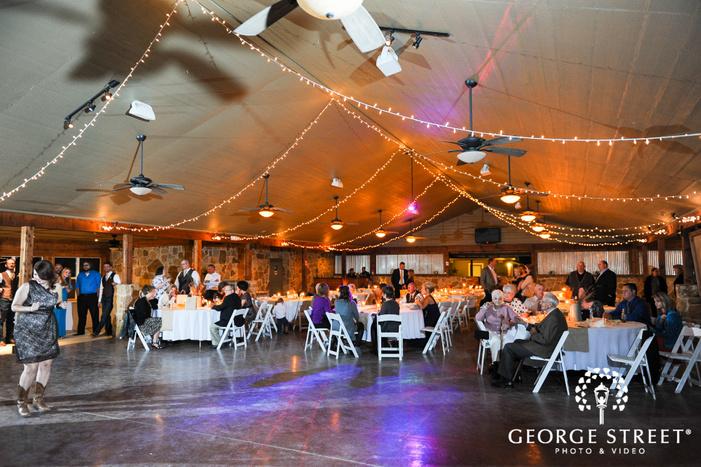 Farmhouse wedding reception room with lights