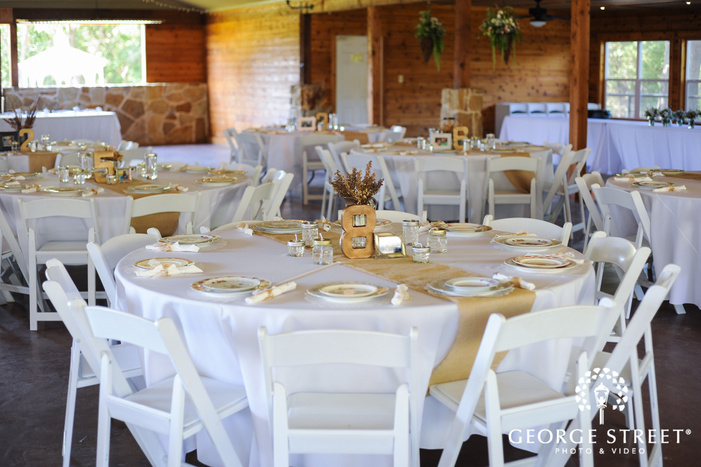 White and gold wedding reception tables