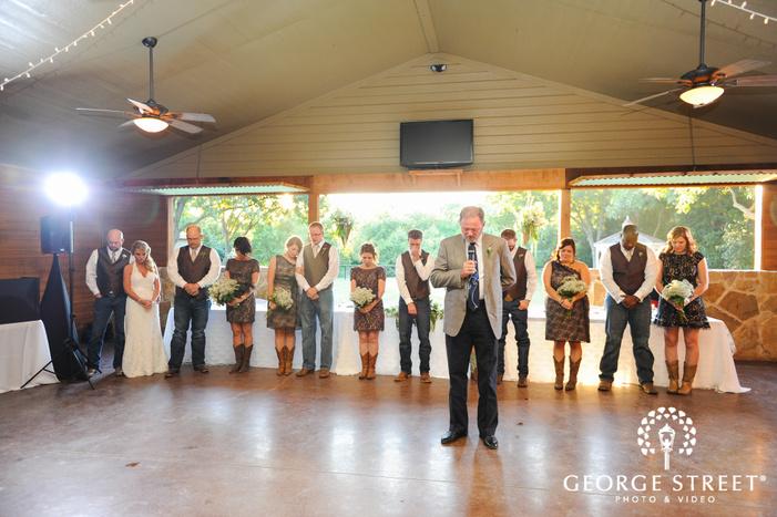 bridal party praying at wedding reception