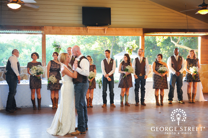 bride and groom first dance with wedding party