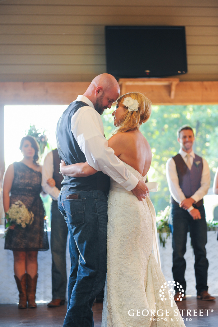 bride and groom gazing first dance