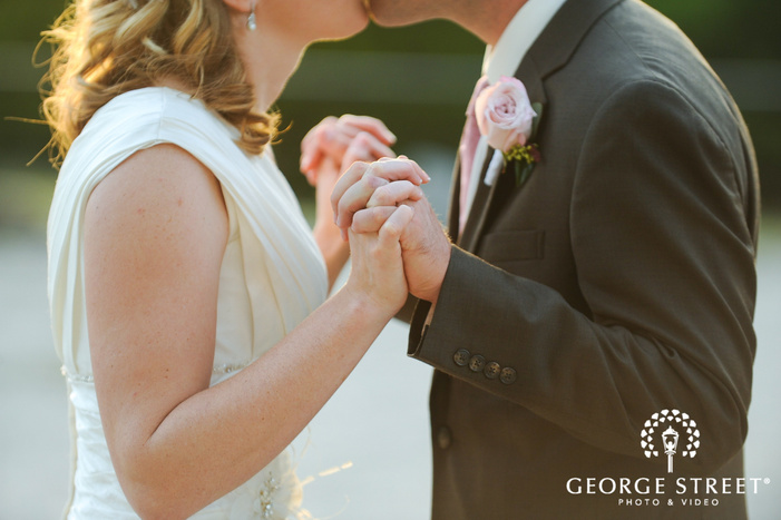 bride and grooms hands detail photo during golden hour