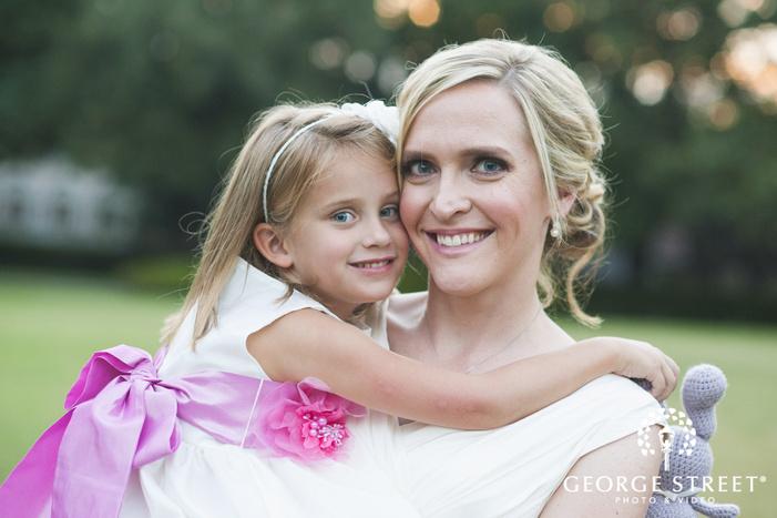 flower girl hugging bride