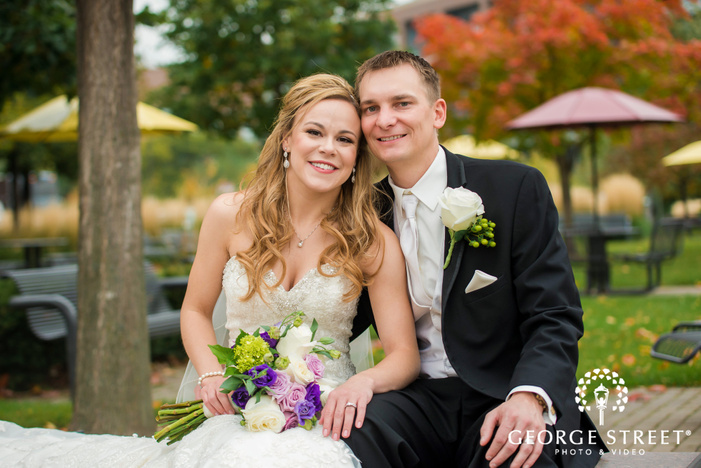 adorable bride and groom in greenery