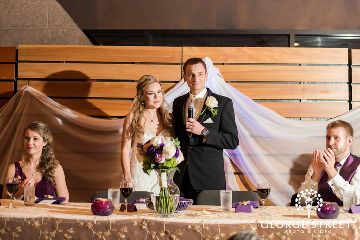 blissful bride and groom speech at reception