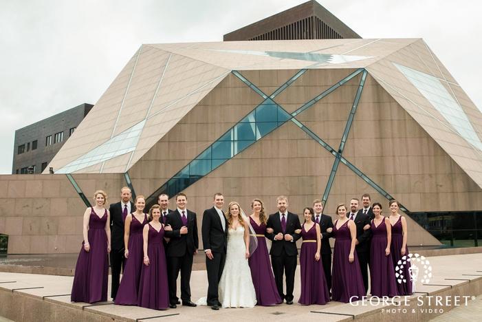 charming couple with bridesmaids and groomsmen at mcnamara alumni center in minneapolis