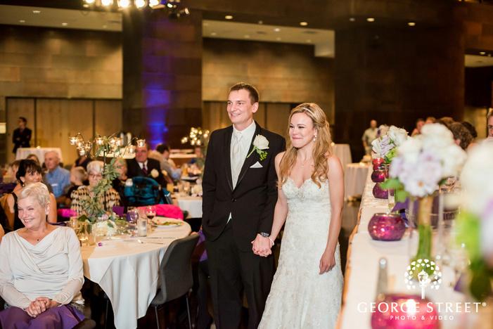 happy bride and groom at reception entrance
