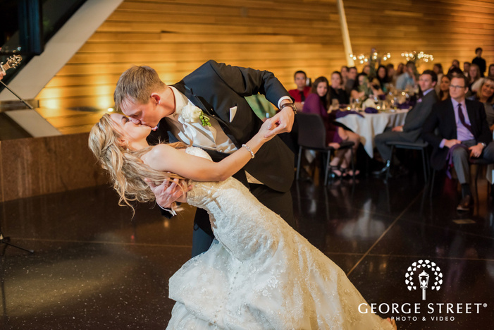 lovable bride and groom at reception dance