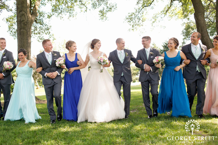 bride and groom with wedding party portrait