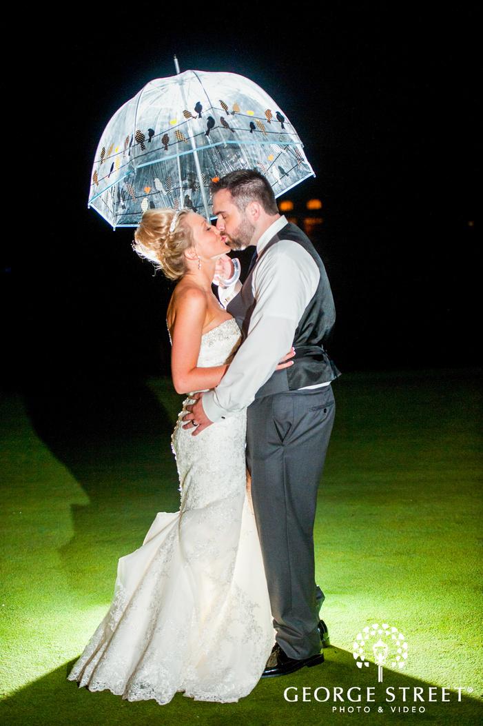 bride and groom outdoor portrait at night umbrella prop