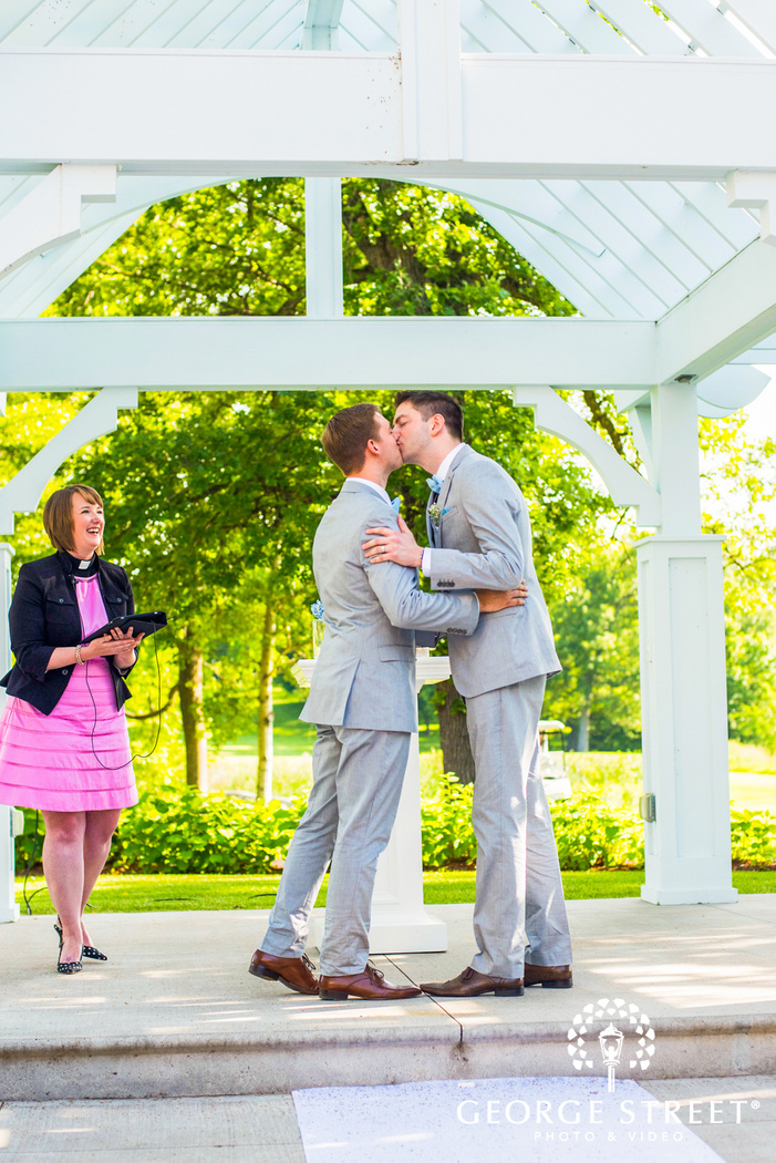 lgbtq grooms wedding ceremony first kiss