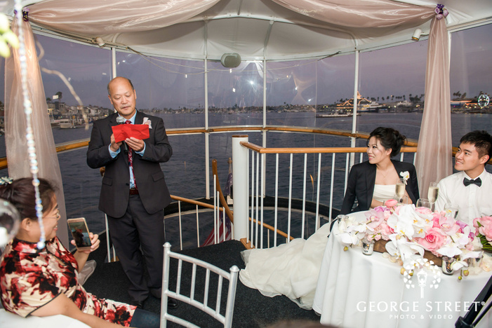 charming bride and groom during reception toast wedding photo