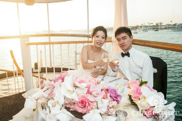 cheerful bride and groom on riverside