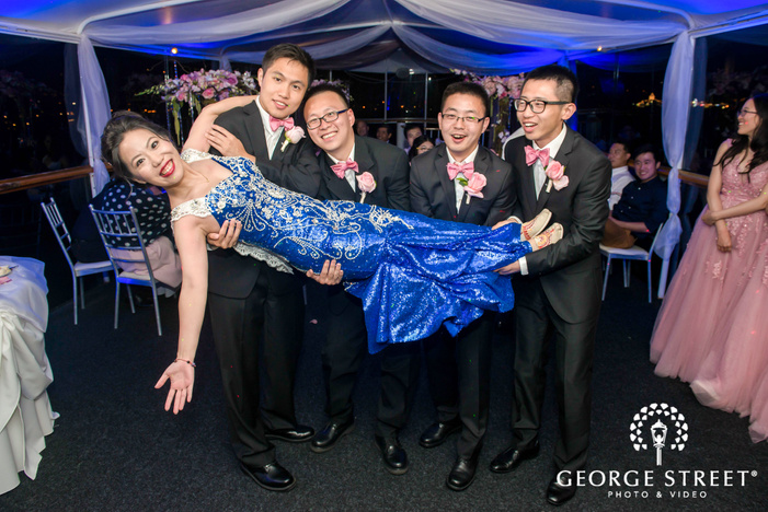 cheerful bride and groomsmen at reception