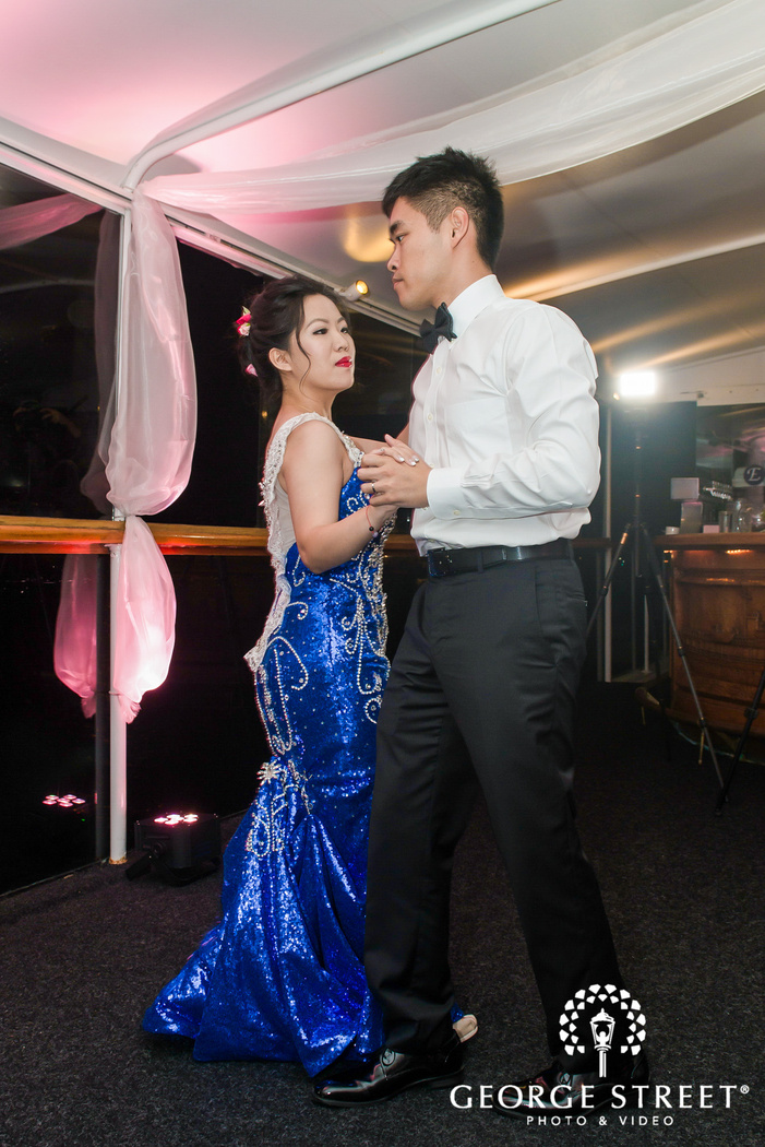 cute bride and groom at reception dance