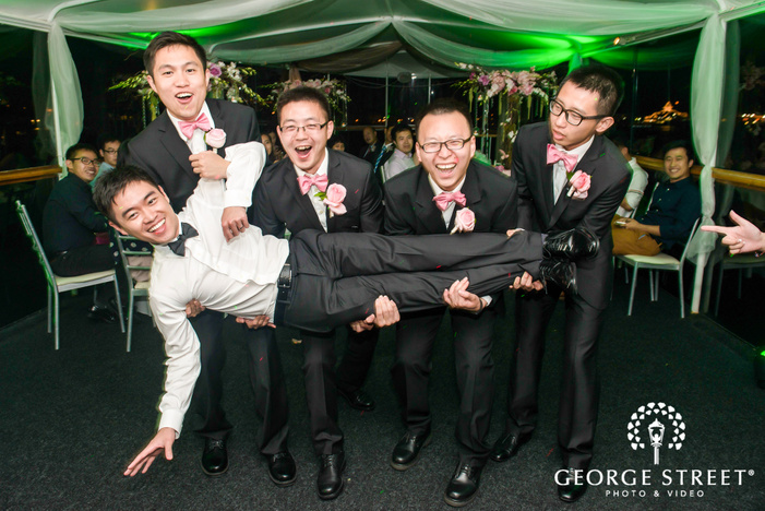excited groom and groomsmen at reception