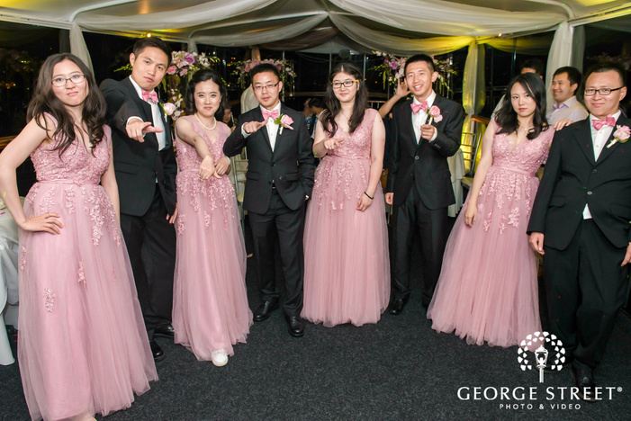 excited groomsmen nd bridesmaids at reception