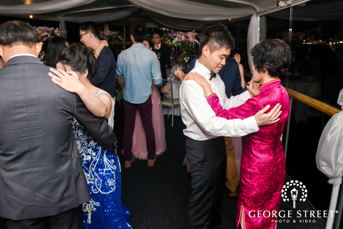 handsome groom and mother at reception dance