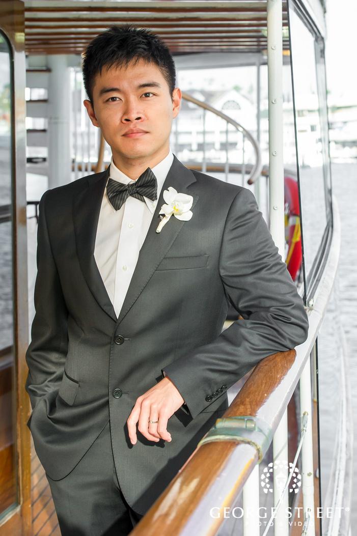 handsome groom on riverside