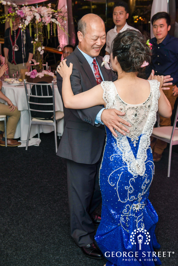 happy bride and father at reception dance