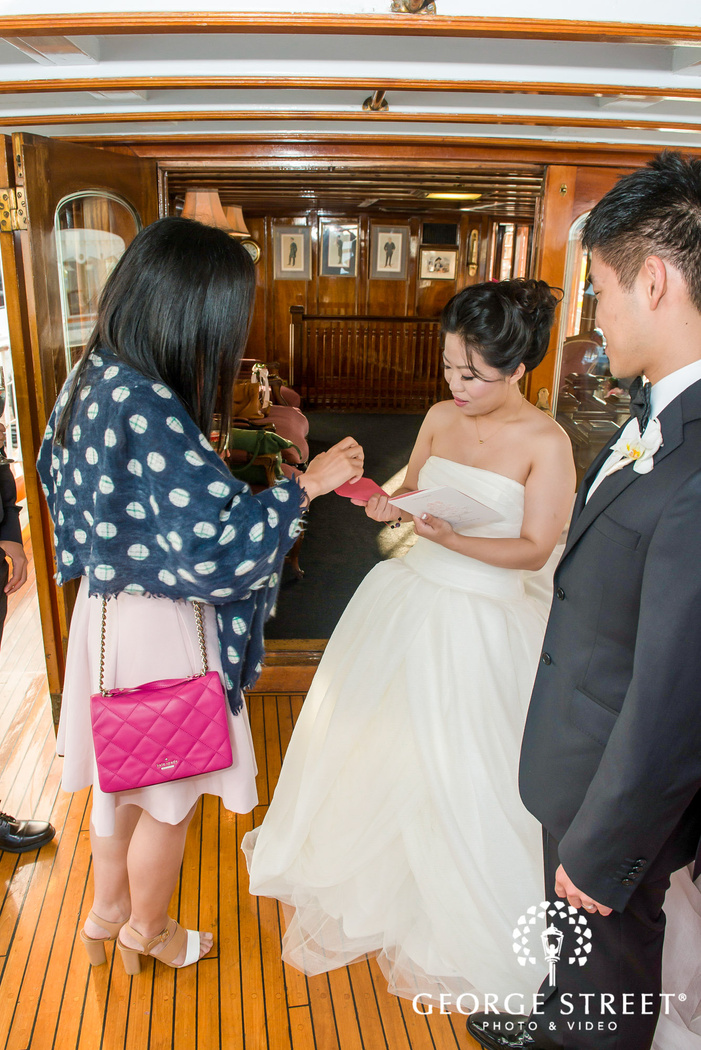 happy bride and groom with guest on reception