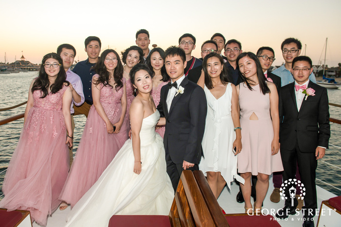 happy group with couple wedding photo