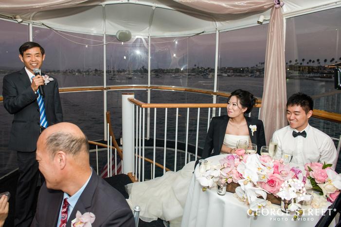 joyful bride nd groom during reception toast