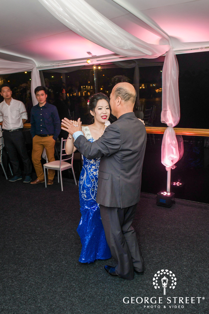 loving bride and groom at reception dance at electra cruises in los angeles
