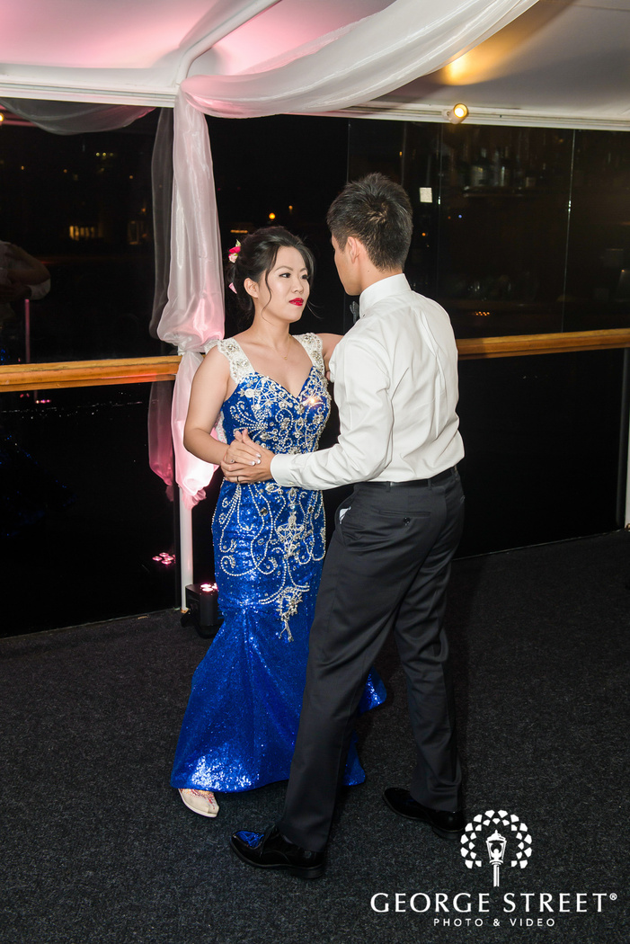 pretty bride and groom at reception dance