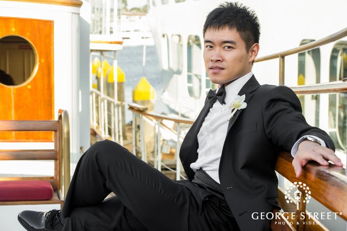 stunning groom on bench