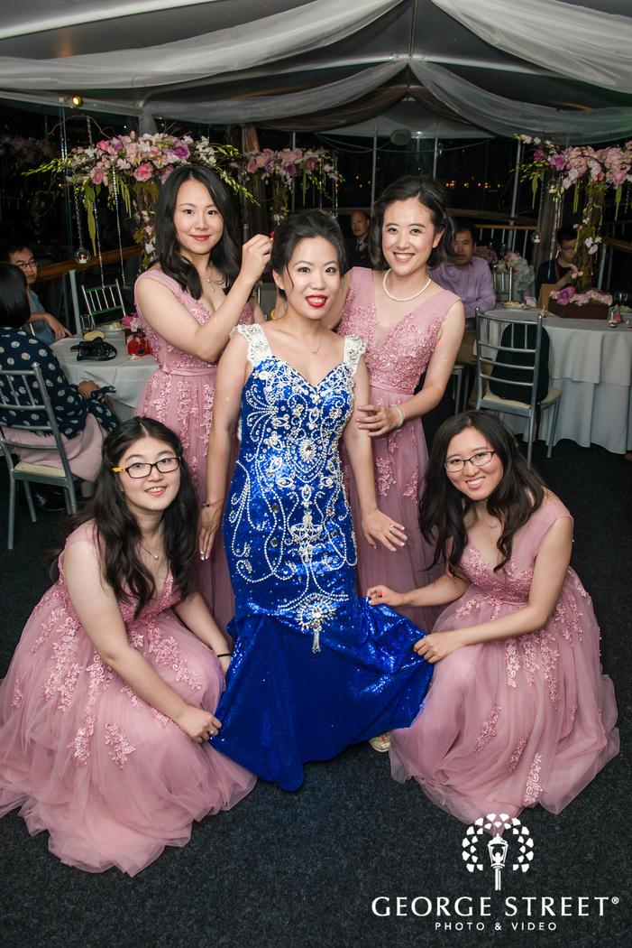 sweet bride and bridesmaids at reception