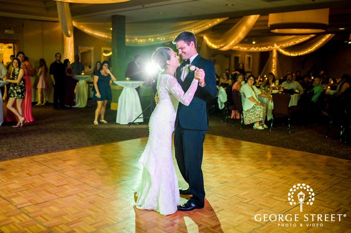 joyful bride and groom first dance at edinburgh golf course hall in minneapolis wedding photos
