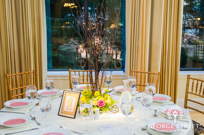 candelabra centerpiece with flowers and white and pink reception decor in gold room