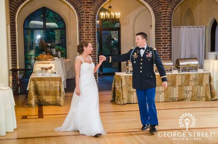 candid bride and military groom wedding reception entrance