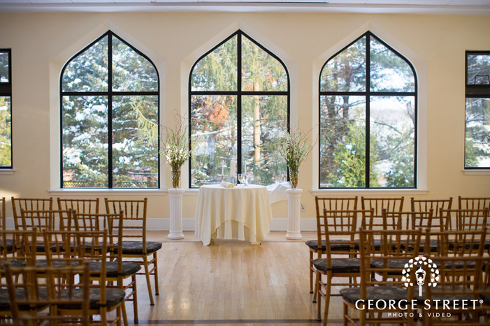 indoor wedding ceremony  with sunny windows at aldie mansion in winter