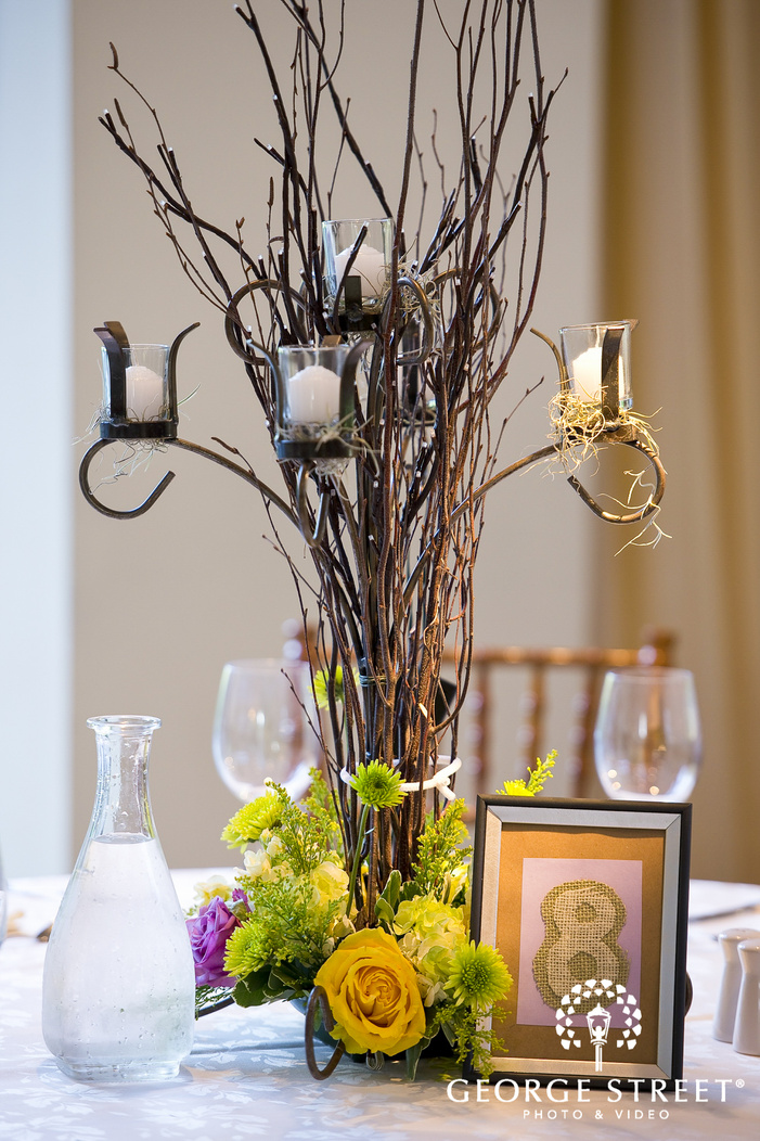 iron candleabra centerpiece with flowers and reception decor