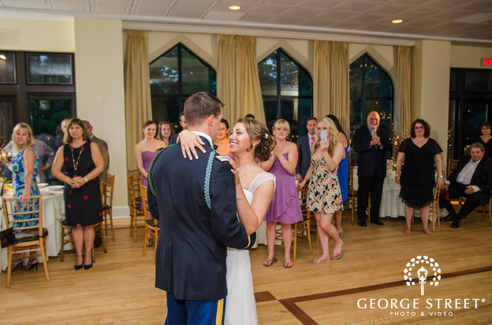 smiling bride and military groom first dance