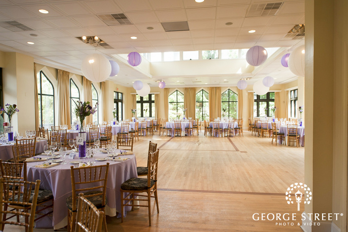 white and purple reception decor with hanging paper lanterns