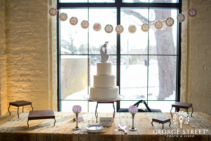 white tiered cake in sunny snowy window