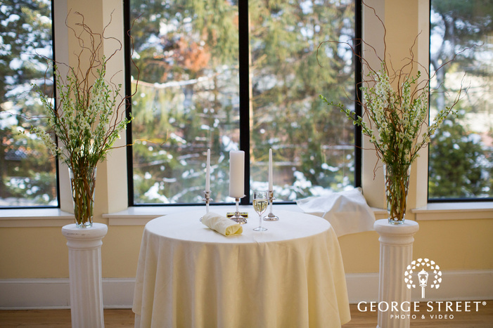 wine and candles on table at aldie mansion indoor wedding ceremony