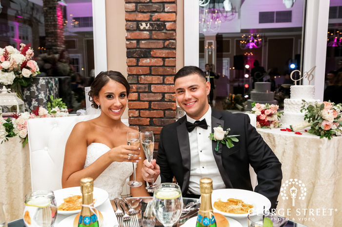 adorable bride and groom in reception at coral house wedding photos