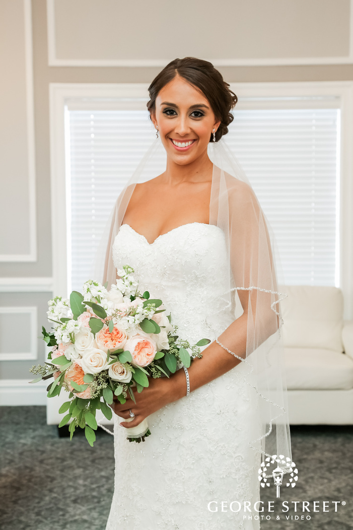 adorable bride in lobby of coral house in new york wedding photography