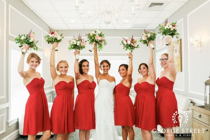 cheerful bridesmaids in getting ready room at coral house wedding photos