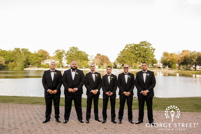 cheery groomsmen at pondside in new york wedding photos